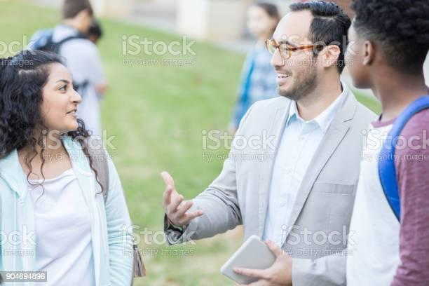 High school teacher greets students outside between classes picture id904694896?b=1&k=6&m=904694896&s=612x612&h=n9tzdmv5p kymx6fdmmll5zlsygpfn1tv5pby8j1r0m=