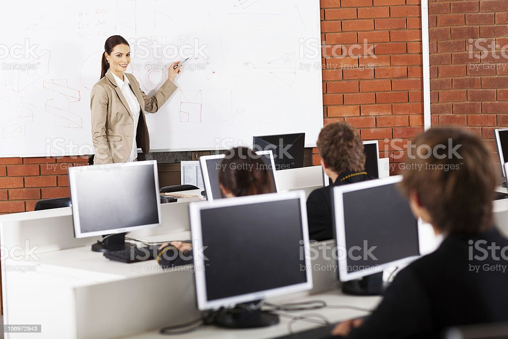 high school teacher teaching stock photo