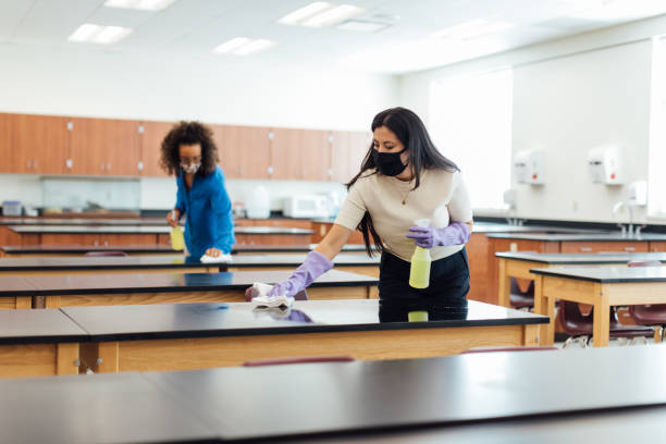 High School Teachers Cleaning Classroom during COVID-19