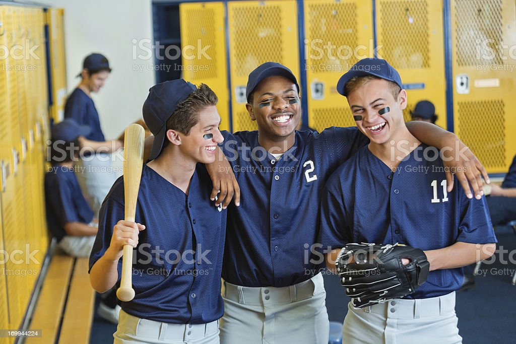 High school teammates in locker room after baseball game stock photo
