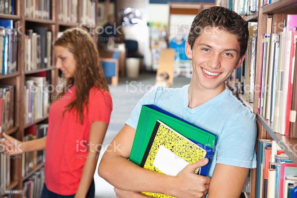 High school teenager in the library royalty-free stock photo