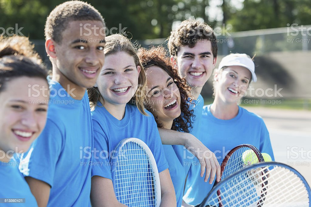 High school tennis team with coach. stock photo