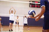 High School Volleyball Match In Gymnasium