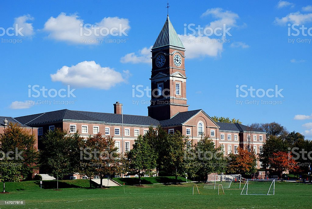 High school with soccer field stock photo
