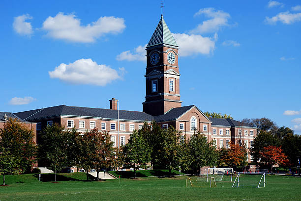 high school with soccer field - private school stock photos and pictures