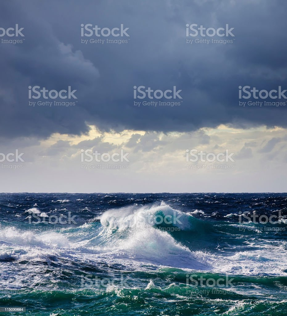 A high, sea wave rising to crash upon the shore stock photo