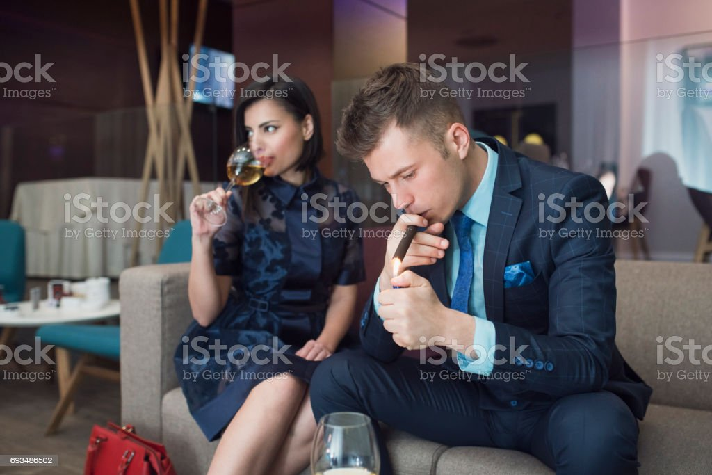 Portrait of an elegant high society couple. Handsome young...