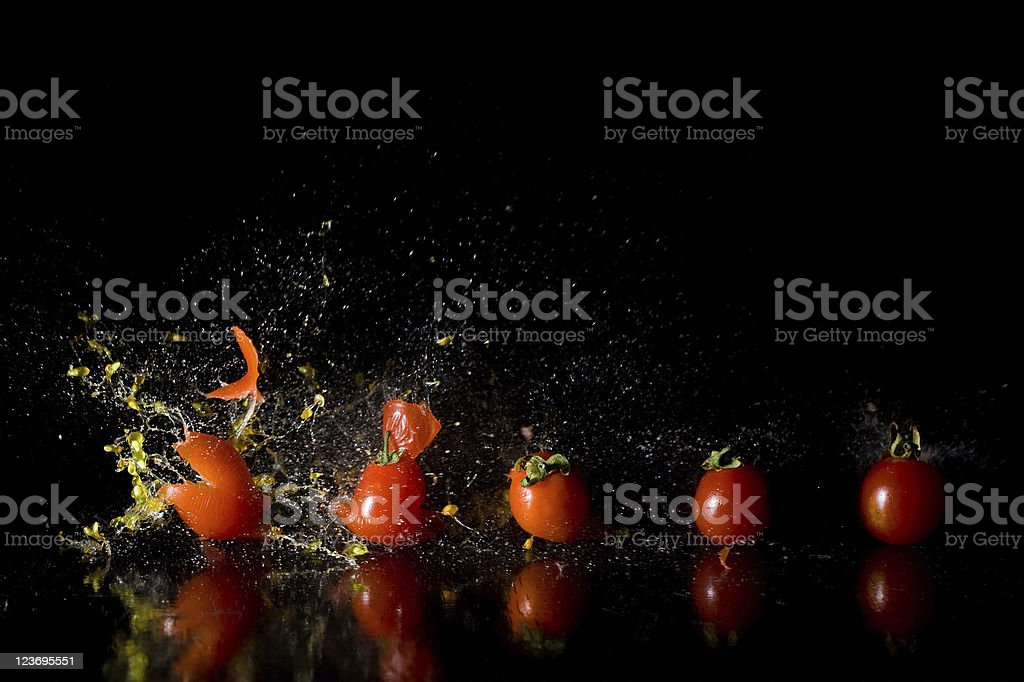 High speed exploding tomato stock photo