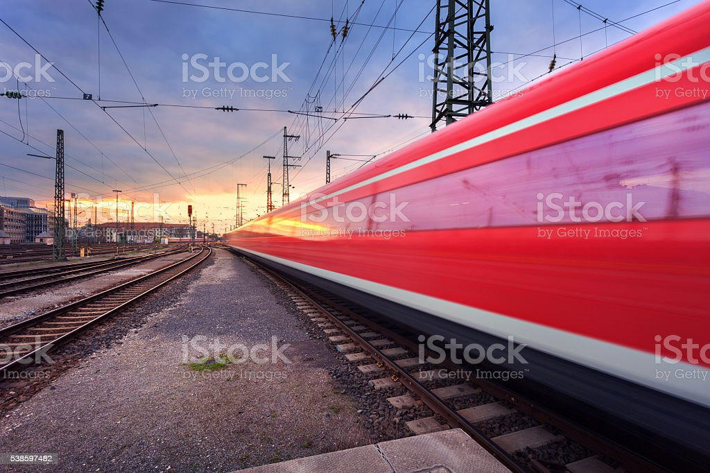 High speed passenger train on railroad track in motion stock photo
