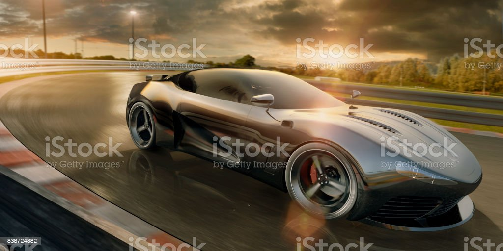 High Speed Sports Car on Race Track At Sunset stock photo
