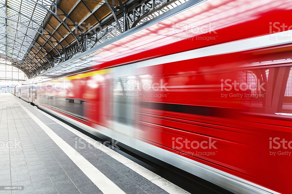High speed train at station platform stock photo