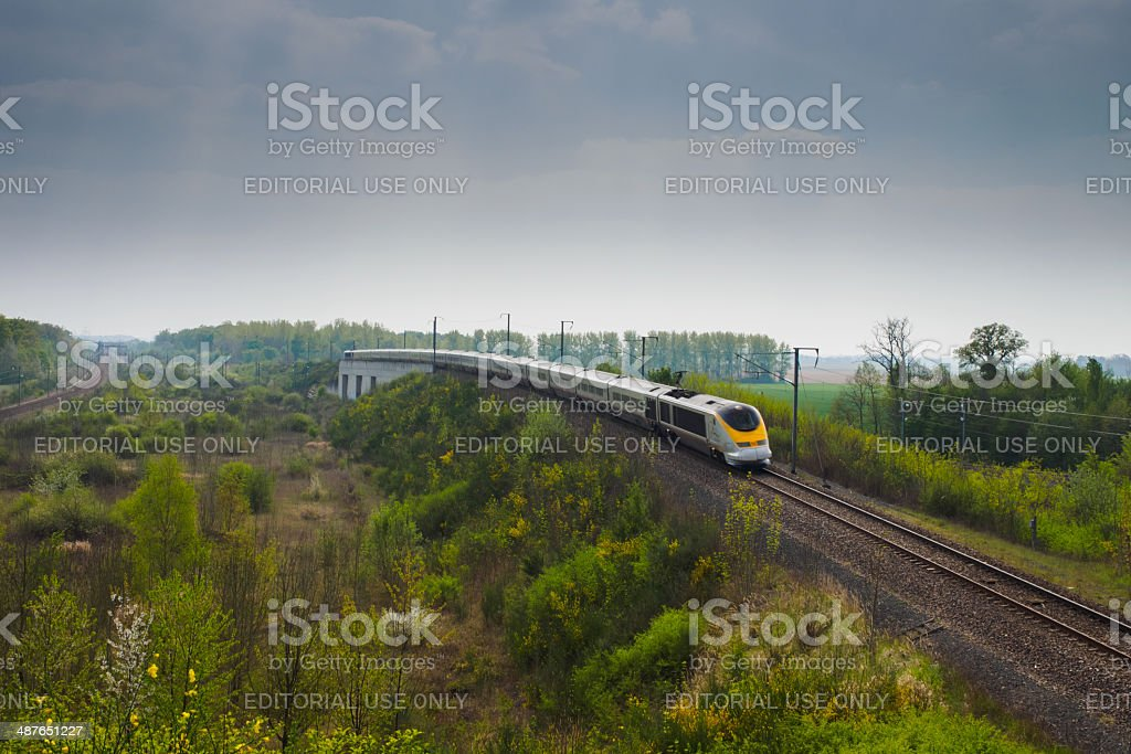 High speed train Eurostar between forest stock photo