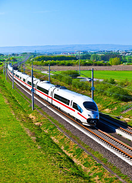 high speed train in open area high speed train with full speed in landscape bullet train stock pictures, royalty-free photos & images