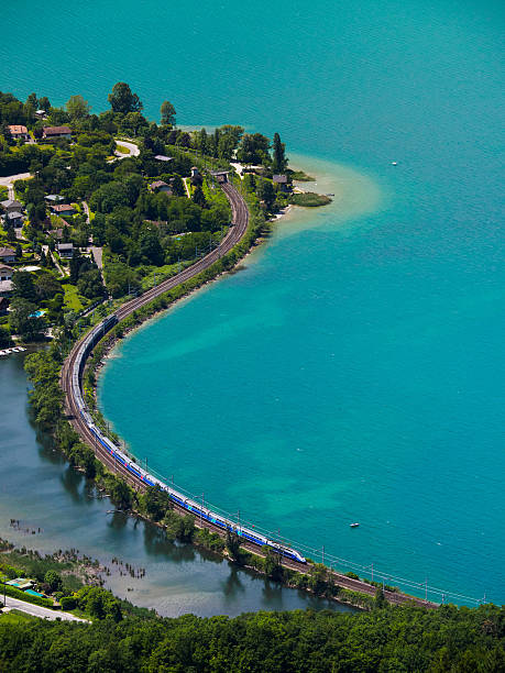 High speed train running aside a lake stock photo