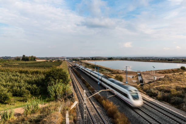 High Speed Train Running in Lleida Province (Spain) High Speed Train Running in Lleida Province (Spain) bullet train stock pictures, royalty-free photos & images