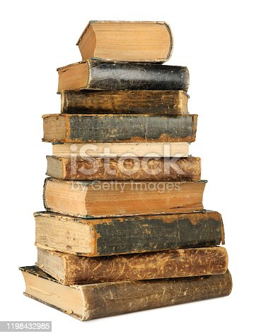 Isolated books. High stack of brown and black old books isolated on white background with clipping path