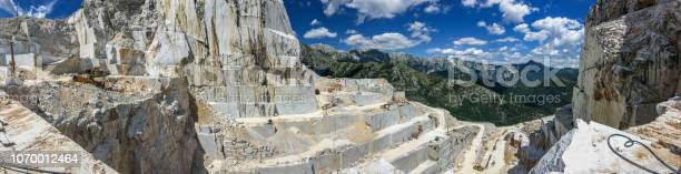Photo of High stone mountain and marble quarries in the Apennines in Tuscany