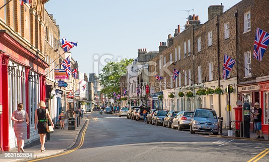 1125782554 istock photo High street of Eton, decorated with flags and people making shopping and walking by. England UK. 963152534