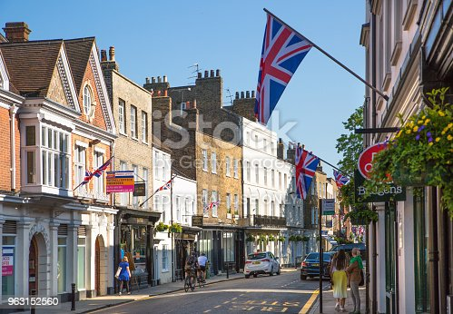 1125782554 istock photo High street of Eton, decorated with flags and people making shopping and walking by. England UK. 963152560
