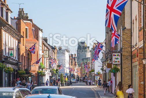 1125782554 istock photo High street of Eton, decorated with flags and people making shopping and walking by. England UK. 963152570