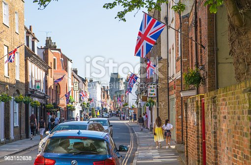 1125782554 istock photo High street of Eton, decorated with flags and people making shopping and walking by. England UK. 963152638