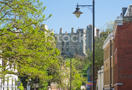 1125782554 istock photo High street of Windsor, and Windsor castle at the background. England UK. 963152434