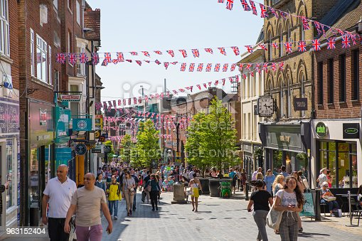 1125782554 istock photo High street of Windsor, decorated with flags and lots of people. tourists making shopping and walking by. England UK. 963152404