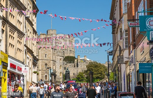 1125782554 istock photo High street of Windsor, decorated with flags and lots of people. tourists making shopping and walking by. England UK. 963152410