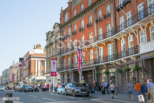 1125782554 istock photo High street of Windsor, decorated with flags and lots of people walking by. England UK. 963152772