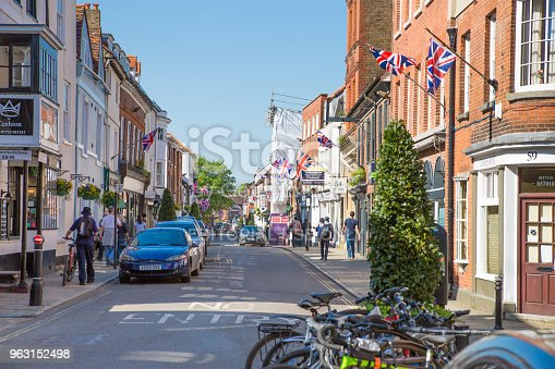1125782554 istock photo High street of Windsor, decorated with flags and people making shopping and walking by.. England UK. 963152498