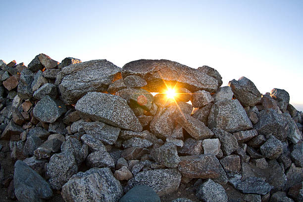 High Summit Sunrise Sunrise peaking through a wall of rocks to protect from the wind at the top of Mt Baldy, California mount baldy stock pictures, royalty-free photos & images