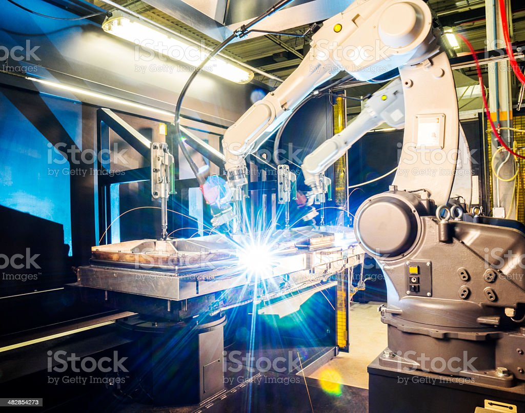 High tech robotic welder in modern metal factory stock photo