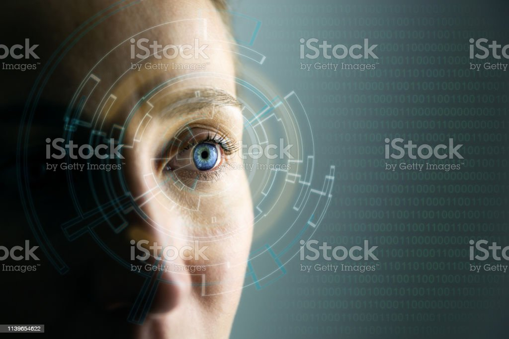 High Technologies in the future. Young woman's eye and high-tech concept, augmented reality display, wearable computing High Technologies in the future. Young woman's eye and high-tech concept, augmented reality display, wearable computing Abstract Stock Photo