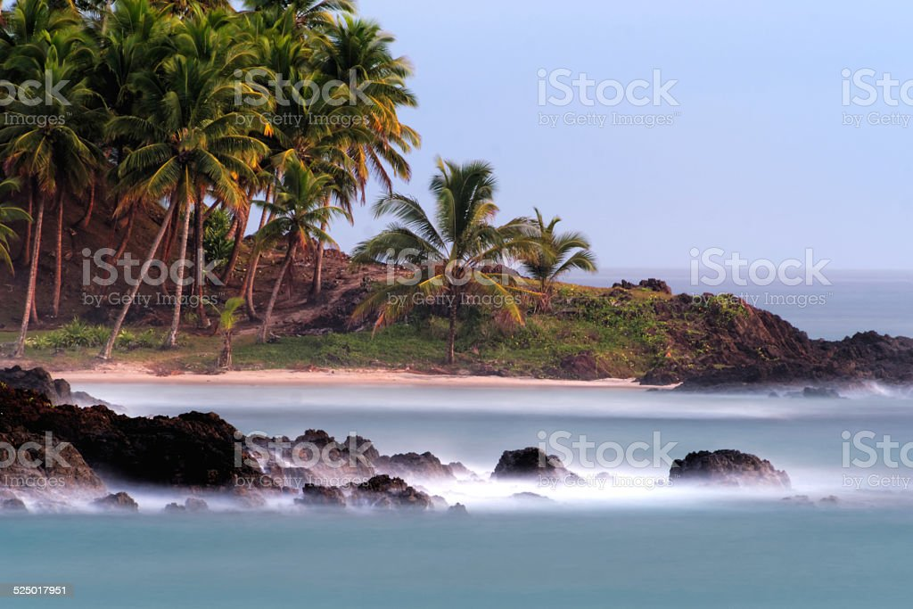 High tide at Jeribucaçu beach, with mist covering the ocean. stock photo