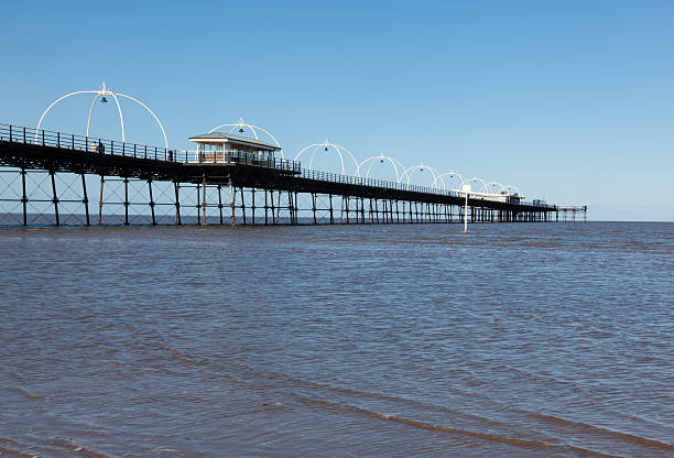 High tide at Southport pier in England stock photo
