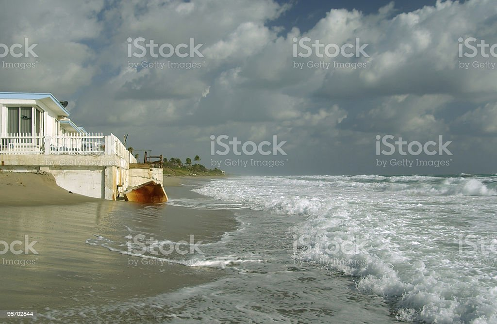 high tide laps foundation of beachfront cottage in south florida royalty-free stock photo