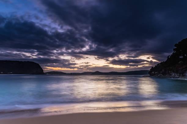 High Tide Swells Up Sunrise Seascape stock photo
