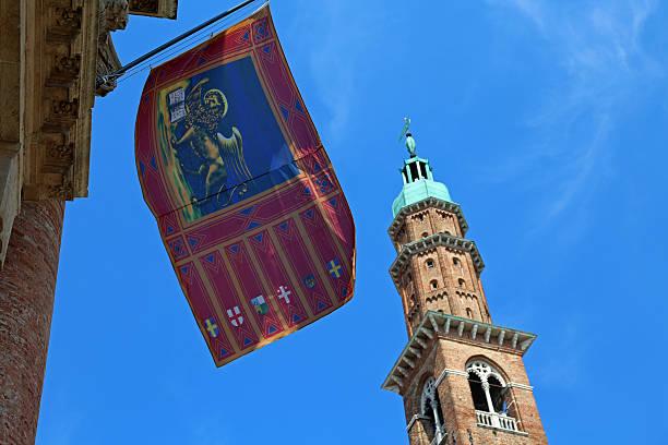 high tower with flag in vicenza city italy - ein topf wunder stock-fotos und bilder