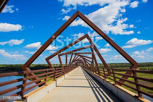 Madrid, Iowa, USA - September 23, 2019. A bright summer day illuminates the High Trestle Trail Bridge, an architectural landmark made using old railway spars.