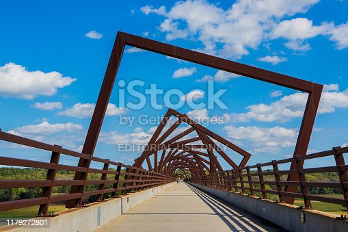 Madrid, Iowa, USA - September 23, 2019. A bright summer day illuminates the High Trestle Trail Bridge, an architectural landmark made using old railway spars.