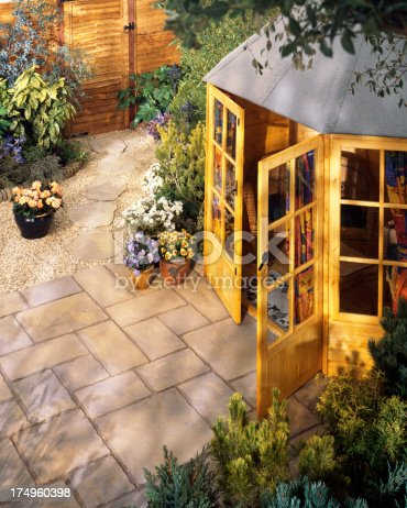 Colourful patio area with garden shed