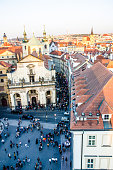High view of Prague with St. Francis of Assisi church and crowd
