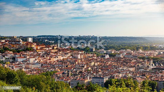 High angle view of the famous Croix Rousse district with red roofs viewed from the Fourviere hill. Taken during a sunny summer day in Lyon city in Rhone department, Auvergne-Rhone-Alpes region in France Europe.