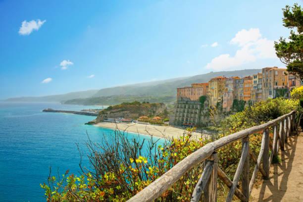 high view of tropea town and empty beach. calabria, italy - foto di tropea foto e immagini stock