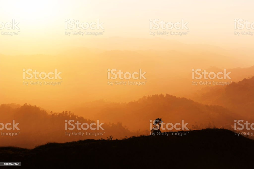 high view sunset over rainforest with layer mountain royalty-free stock photo