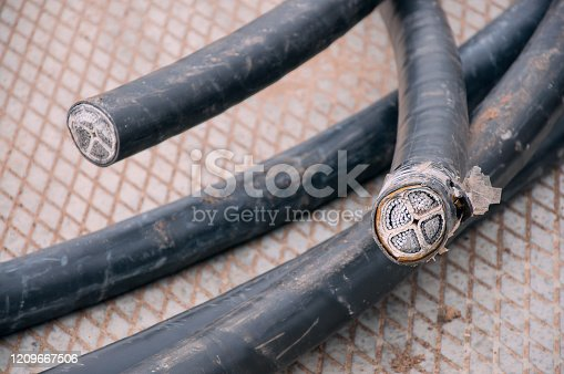 istock High voltage cable cut. Electrical Products. Many leads and shileding cables 1209667506