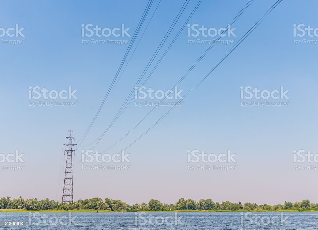 High voltage cable laid across the river stock photo