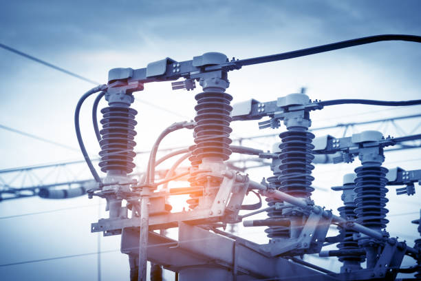 high voltage circuit breaker in a power substation - capacitor stock photos and pictures