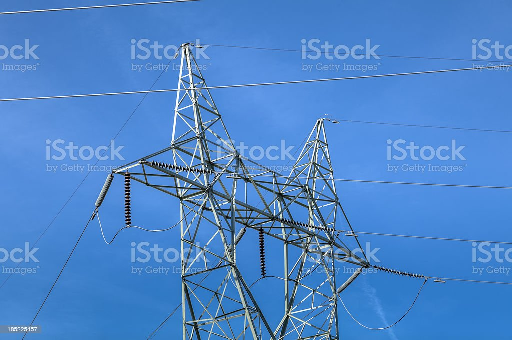 High Voltage Electric Towers under Clear Blue Sky stock photo