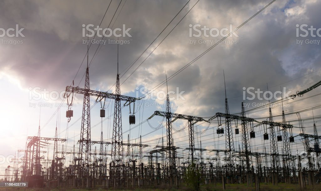 High-voltage power lines. Electricity distribution station. high...